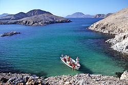 Earthwatchers Arriving On Boat To Island