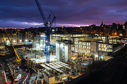 Night view of construction site of NW Phase 2 Offices project. Mixed commercial, retail and residential development in Edinburgh Old Town. Contractor McAleer & Rushe. Scotland , United Kingdom