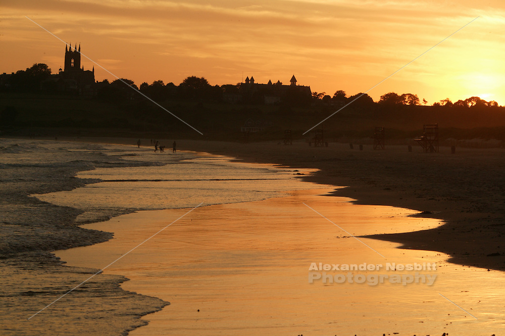 USA, Newport, RI -  Setting sun reflects of wet sand on Second beach