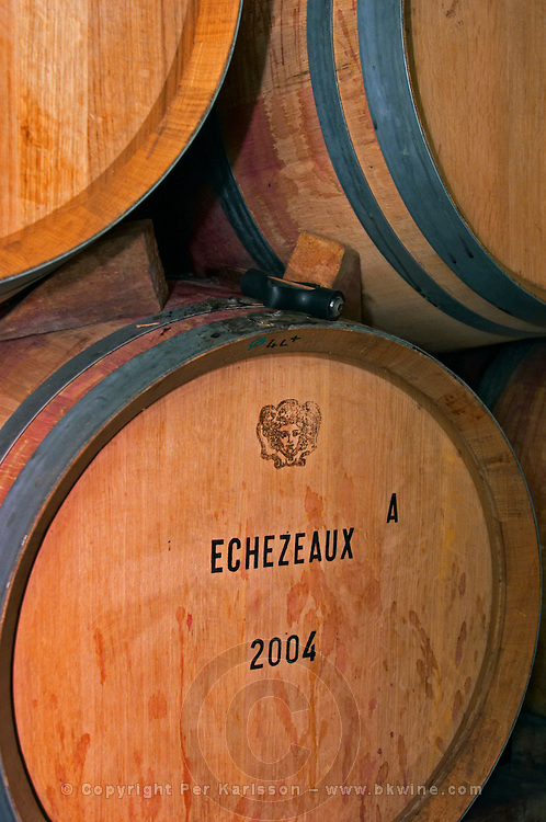 An oak barrel stamped with Echezeaux 2004 and the Jadot symbol of Baccus, Maison Louis Jadot, Beaune Côte Cote d Or Bourgogne Burgundy Burgundian France French Europe European
