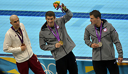 Aug. 2, 2012 - London, England, United Kingdom - Hungary's Laszio Pereira (Bronze medalist), Michael Phelps (Gold medalist) and Ryan Lochte (Silver medalist) acknowledge the audience after receiving their medals for the  Men's 200m Individual Medley  (Credit Image: © Bruce Chambers/The Orange County Register/ZUMAPRESS.com)