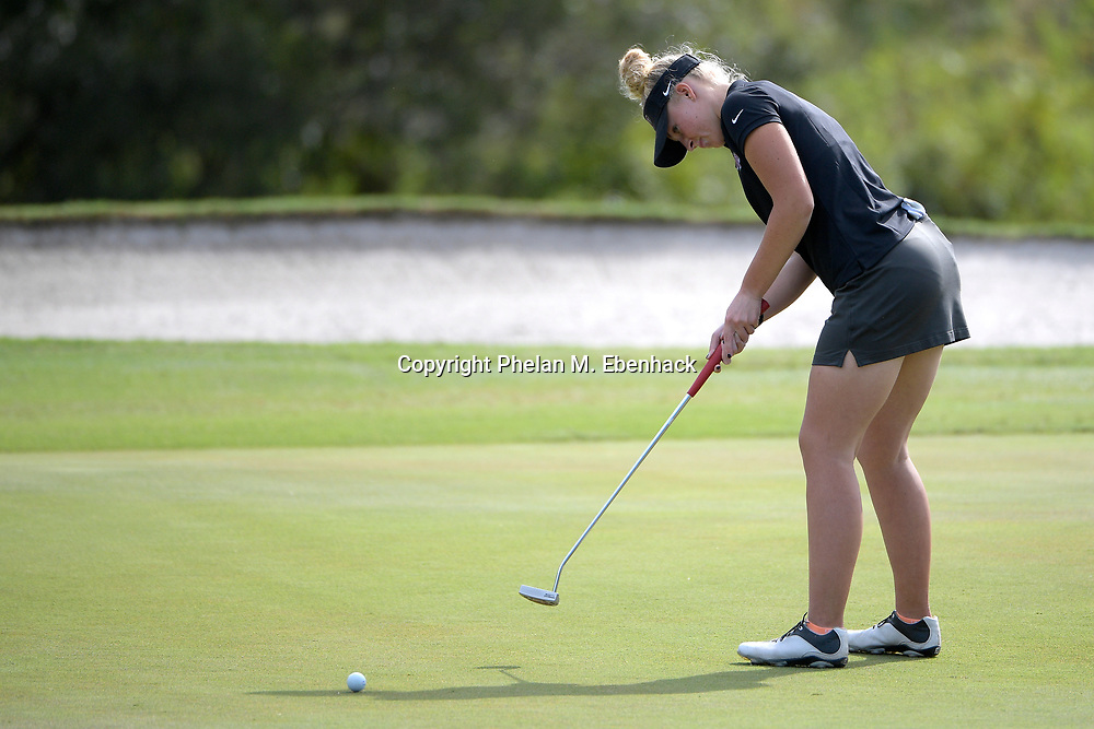 Lake Mary Prep's Claire Hodges watches her putt on the 18th green during the FHSAA State 1A Golf Championships in Howey in the Hills, Fla., Saturday, Oct. 29, 2016. (Photo by Phelan M. Ebenhack)