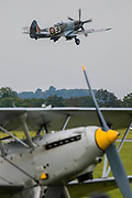 18 Spitfires take off, behind other classic planes, from the grass airstrip for the final flypast - The Duxford Battle of Britain Air Show is a finale to the centenary of the Royal Air Force (RAF) with a celebration of 100 years of RAF history and a vision of its innovative future capability.