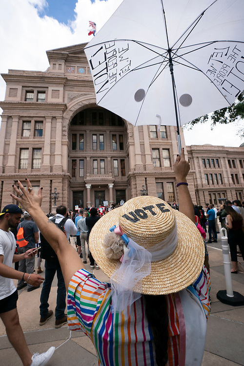 Jessica Ramirez of Austin shows her support as a coalition of voting rights groups including Black Voters Matter and the Texas Right to Vote Coalition rally at the Capitol to decry voter supression bills being advocated by Gov. Greg Abbott.