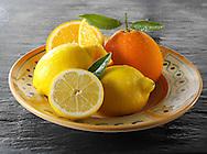 Fresh whole oranges and lemons