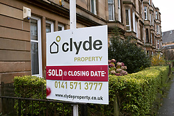Sold sign outside tenement apartment building in Govanhill district of Glasgow, Scotland, United Kingdom