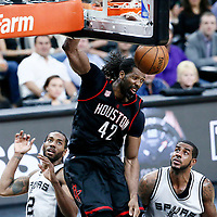 03 May 2017: Houston Rockets center Nene Hilario (42) dunks the ball over San Antonio Spurs forward Kawhi Leonard (2) and San Antonio Spurs forward LaMarcus Aldridge (12) during the San Antonio Spurs 121-96 victory over the Houston Rockets, in game 2 of the Western Conference Semi Finals, at the AT&T Center, San Antonio, Texas, USA.