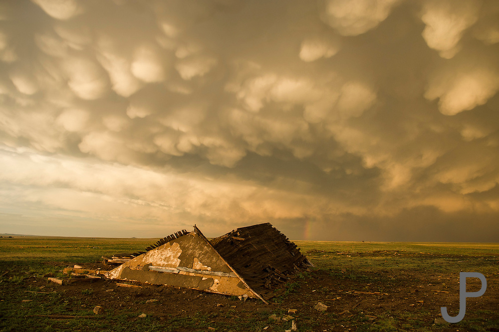 A huge summer thunderstorm rolls out of the Rockies and dumps large amounts of rain and hail in the plains of eastern New Mexico. I think this picture tells how difficult it is to live in eastern New Mexico.  It shows the isolation, the extreme weather, and the lack of hope.