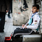A young musician plays a keyboard connected to a wind element in the Beyoglu district of Istanbul, Turkey.
