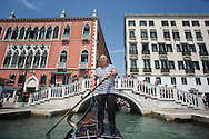Gondolas on the Grand Canal and smaller canals in Venice. Gondoliers do well when the weather is good.