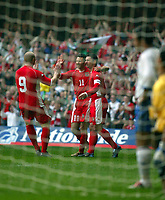Photo: Scott Heavey<br />Wales V Azerbaijan. 29/03/03.<br />John Hartson celebrates with Ryan Giggs and Gary Speed after the first minute goal during this afternoons Euro 2004 Group 9 qualifying match at the Millenium stadium in Cardiff.
