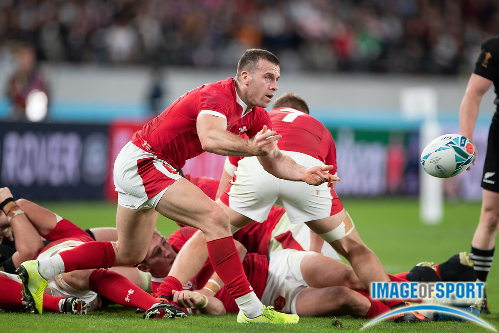 Tomos Williams of Wales passes the ball during the Rugby World Cup bronze final match between New Zealand and Wales Friday, Nov, 1, 2019, in Tokyo. New Zealand defeated Wales 40-17.  (Flor Tan Jun/Espa-Images-Image of Sport)
