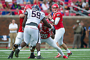 DALLAS, TX - NOVEMBER 16: Garrett Gilbert #11 of the SMU Mustangs drops back to pass against the Connecticut Huskies on November 16, 2013 at Gerald J. Ford Stadium in Dallas, Texas.  (Photo by Cooper Neill/Getty Images) *** Local Caption *** Garrett Gilbert