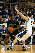 FORT WORTH, TX - JANUARY 7: Omari Lawrence #12 of the Kansas State Wildcats drives to the basket against the TCU Horned Frogs on January 7, 2014 at Daniel-Meyer Coliseum in Fort Worth, Texas.  (Photo by Cooper Neill/Getty Images) *** Local Caption *** Omari Lawrence