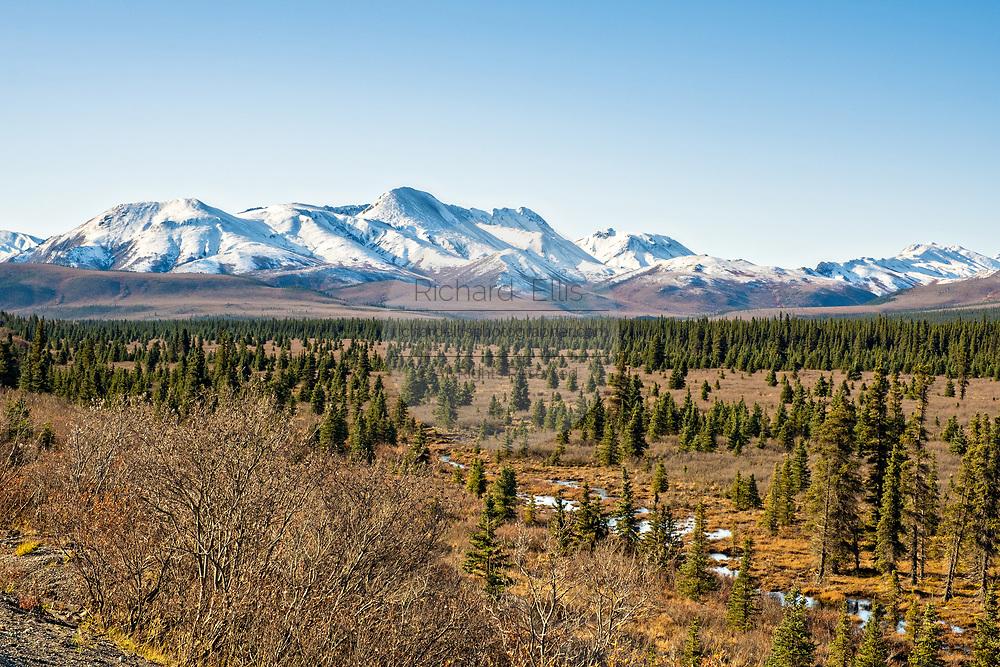An early season snow dusts the Alaskan Range of mountains in Denali National Park, McKinley Park, Alaska