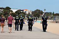 Police patrol St Kilda Beach during COVID-19 in Melbourne, Australia. Premier Daniel Andrews comes down hard on Victorians breaching COVID 19 restrictions, threatening to close beaches if locals continue to flout the rules. This comes as Victoria sees single digit new cases. (Photo by Dave Hewison/Speed Media)