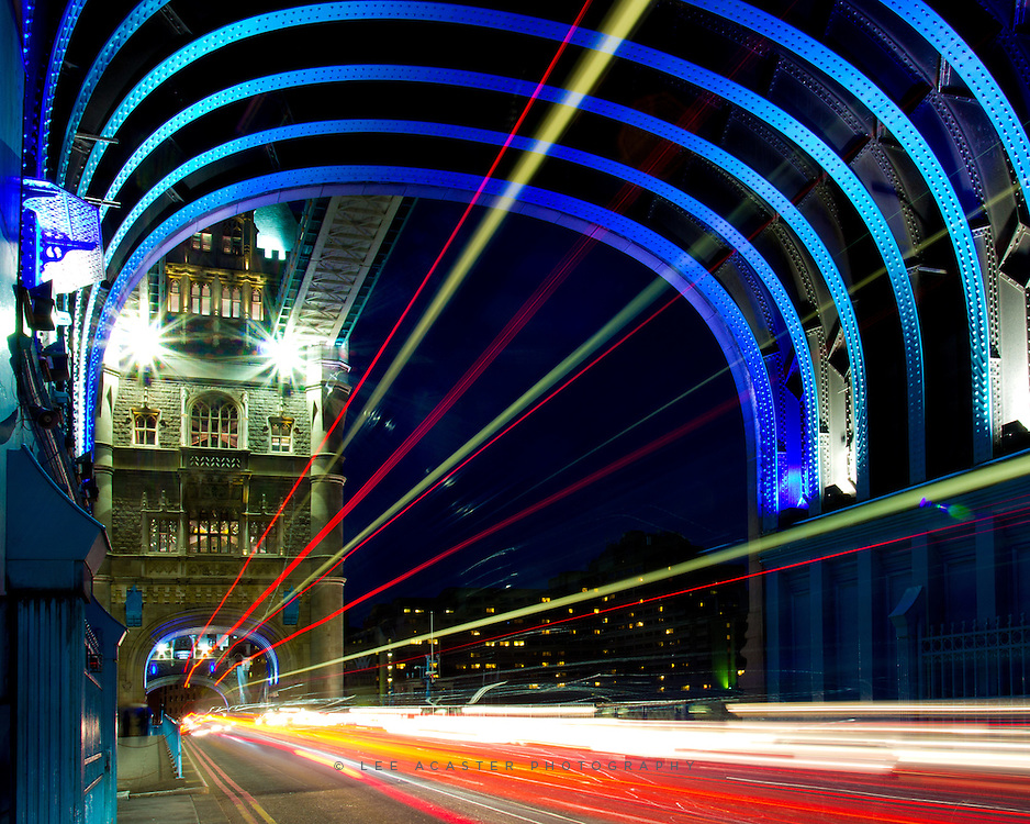 Another one from Tower Bridge, long exposure to turn the buses and cars into light streaks. The funky colours are just the way the bridge is lit!