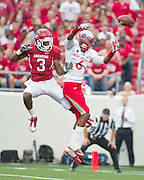 Sep 10, 2011; Little Rock, AR, USA; New Mexico Lobos defensive back Anthony Hooks (6) breaks up a pass intended for Arkansas Razorback wide receiver Joe Adams (3) during the first half of a game at War Memorial Stadium.  Mandatory Credit: Beth Hall-US PRESSWIRE
