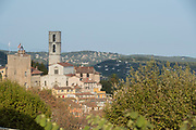 Bell tower of Notre-Dame-du-Puy de Grasse Church on hill over old town, Grasse, France.