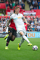 Football - 2017 / 2018 Premier League - Swansea City vs. Manchester United<br /> <br /> Alfie Mawson of Swansea City passes the ball—<br /> , at Liberty Stadium.<br /> <br /> COLORSPORT/WINSTON BYNORTH