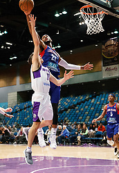 November 19, 2017 - Reno, Nevada, U.S - Long Island Nets Forward KAMARI MURPHY (21) blocks a shot by Reno Bighorns Guard DAVID STOCKTON (11) during the NBA G-League Basketball game between the Reno Bighorns and the Long Island Nets at the Reno Events Center in Reno, Nevada. (Credit Image: © Jeff Mulvihill via ZUMA Wire)