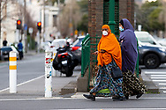 Two Muslim women wearing facemasks walk along Lygon Street during COVID-19. A further 238 Coronavirus cases have been discovered overnight, bringing Victoria's active cases to over 2000, speculation is rising that almost all of Victoria's current cases stem from the Andrews Government botched hotel quarantine scheme as well as the Black Lives Matter protest.  Premier Daniel Andrews warns that Victoria may go to Stage 4 lockdown if these high numbers continue. (Photo be Dave Hewison/ Speed Media)