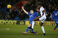 Sammy Ameobi of Bolton Wanderers ® challenges Joe Ralls of Cardiff City. EFL Skybet championship match, Cardiff city v Bolton Wanderers at the Cardiff city Stadium in Cardiff, South Wales on Tuesday 13th February 2018.<br /> pic by Andrew Orchard, Andrew Orchard sports photography.