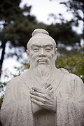A statue of the Chinese philospoher Confucius on the campus of Beijin'f Qinghua University. Denounced as feudalistic in Maoís Cultural Revolution, Confuciusís 2,500-year-old ideas of filial piety and respect for education have found renewed favor since the 1990