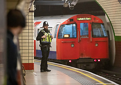 © Licensed to London News Pictures. 17/04/2019. London, UK. A police officer guards a platform at Piccadilly underground station after XR (Extinction Rebellion) climate change protest group threatened to continue their demonstrations and blockades on the tube network. XR actions are still blocking traffic at various location across the capital despite nearly 300 arrests and are expected to disrupt underground travel today. Photo credit: Peter Macdiarmid/LNP