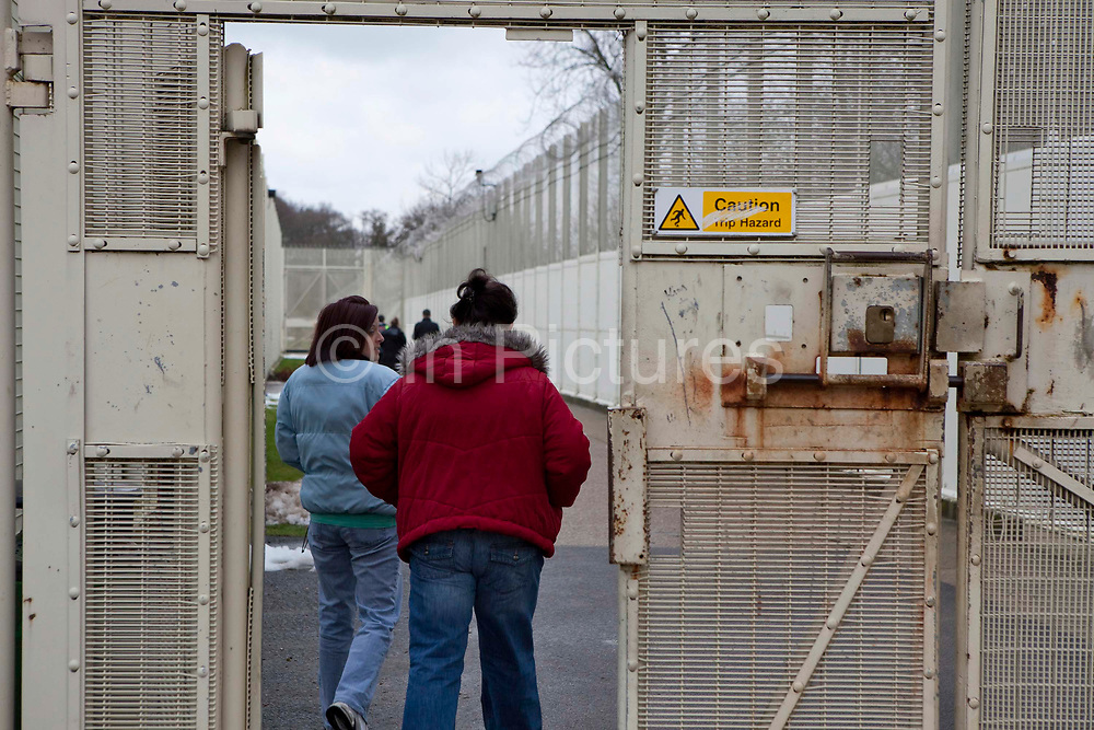 Visitors walking through the secure perimeter gate. HM Prison Send is a Closed Category women's prison, located in the village of Send (near Woking), in Surrey, England. The prison is operated by Her Majesty's Prison Service. Send is a closed prison for adult females. In addition it also houses a 20 bed Addictive Treatment Unit, an 80 bed Resettlement Unit and a 40 bed Therapeutic Community. HMP Sends Education Department runs Key Skills courses and NVQs in Business Administration. The Farms and Gardens department offers Floristry NVQs, and the Works Department run an industrial workshop and painting party. Prisoners held in the Resettlement Unit can also do voluntary work, attend College courses and Work Placements in the outside community.