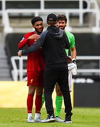 LIVERPOOL, ENGLAND - Sunday, July 26, 2020: Liverpool's Joe Gomez (L) and goalkeeper Alisson Becker (R) celebrate with manager Jürgen Klopp after the final match of the FA Premier League season between Newcastle United FC and Liverpool FC at St. James' Park. The game was played behind closed doors due to the UK government's social distancing laws during the Coronavirus COVID-19 Pandemic. Liverpool won 3-1 and finished the season as Champions on 99 points. (Pic by Propaganda)