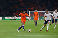 Netherlands forward Memphis Depay (Olympique Lyonnais), attacks the goal with England midfielder Jordan Henderson during the Friendly match between Netherlands and England at the Amsterdam Arena, Amsterdam, Netherlands on 23 March 2018. Picture by Phil Duncan.