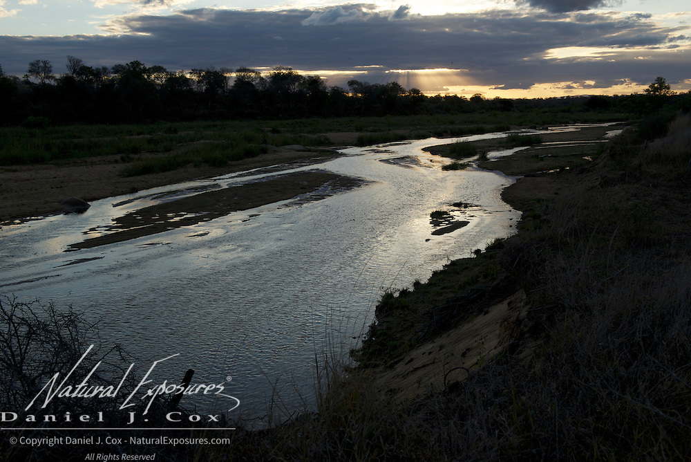 Evening sun sets over the Sand River in MalaMala Gamer Reserve, South Africa.