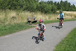 Cyclists at Sence Valley Forest Park, Leicestershire, on site of former opencast colliery