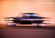 Classic American car speeding down the Malecon road, Havana, Cuba
