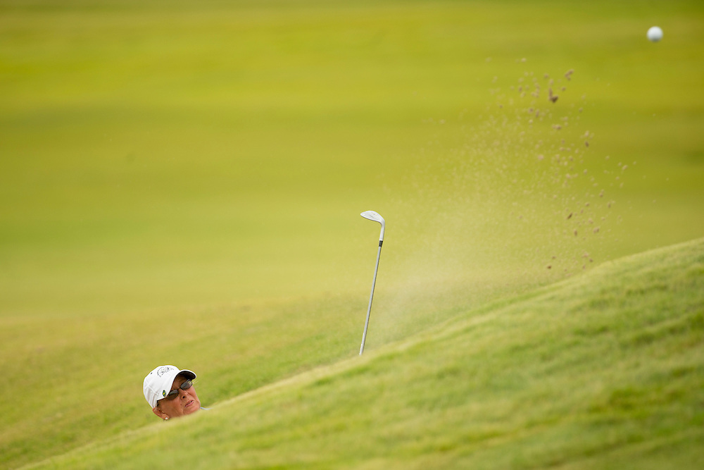 Liz Waynick plays a shot from a greenside bunker at the ninth hole as seen during the final round of match play at the 2012 U.S. Women's Mid-Amateur at Briggs Ranch Golf Club in San Antonio, Texas on Thursday, Oct. 11, 2012.  (Copyright USGA/Darren Carroll)
