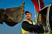 Humir Construction Project Manager Juan Arreloa poses at the company's equipment yard on Chicago's near southwest side.