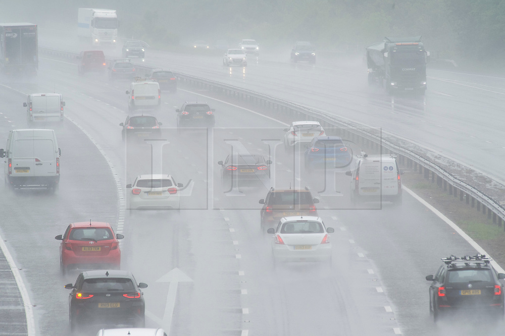 © Licensed to London News Pictures 04/06/2021. Swanley, UK. M25 rainy weather. No more sunny weather today as the rain makes a comeback in Kent, roads start to flood and drivers face poor visibility on the M25 near Swanley due to surface rain water. Photo credit:Grant Falvey/LNP