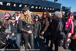 Participants of the Annual MDA Women's ride pose with WIllie G, Nancy and Karen Davidson for a group photo a the Harley-Davidson Display located at the Daytona Speedway during Daytona Bike Week. Daytona Beach, FL. USA. Thursday March 16, 2017. Photography ©2017 Michael Lichter.