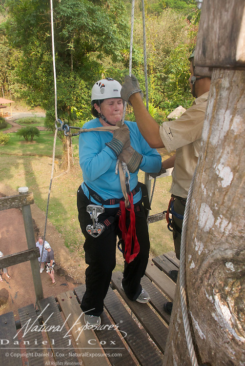 Carol scared out of her mind takes a big breath before repelling. Costa Rica.