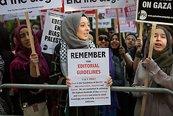 Image ©Licensed to i-Images Picture Agency. 15/07/2014. London, United Kingdom. Demonstration against BBC Israel-Palestine reporting. A demonstrator holds a banners against the BBC and biased reporting in a demonstration against the BBC and their way of reporting the conflict between srael-Palestine. the BBC. Picture by Daniel Leal-Olivas / i-Images