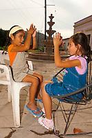 Girls playing patty cake, La Noria, a village in the Sierra Madre Moutains near Mazatlan, Sinaloa, Mexico
