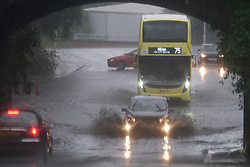 Thunderstorm in Glasgow, 07 August 2021<br /> <br /> Thunderstorms in Glasgow caused flash flooding in Possil Road.<br /> <br /> It caught out pedestrians, cyclists and drivers, some of whom turned back but most took the chance to drive through.<br /> <br /> Alex Todd | Edinburgh Elite Media