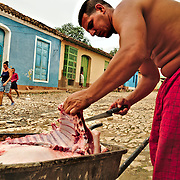 Man selling meat door to door on the first hours of the morning