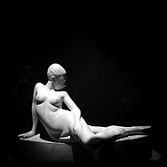 """""""Naked female relaxed"""". Plaster sculpture by Italian sculptor Francesco Ciusa exhibited at Tribu museum in Nuoro (Sardinia), Italy. 2014."""