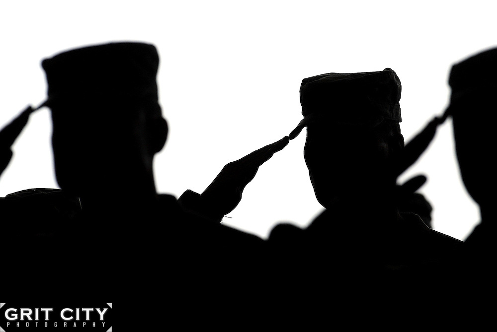 I Corps Soldiers salute during the playing of the National Anthem at a return ceremony at Joint Base Lewis-McChord March 14. The Soldiers returned from a year-long deployment in Iraq.