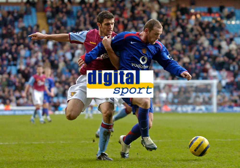 Photo: Glyn Thomas.<br />Aston Villa v Manchester United. The Barclays Premiership.<br />17/12/2005.<br />Manchester United's Wayne Rooney (R) battles for the ball with Aaron Hughes.