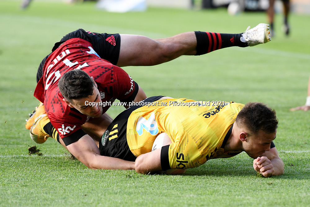 Hurricanes Wes Goosen scores a try past Crusaders Will Jordan in the Super Rugby match, Hurricanes v Crusaders, Sky Stadium, Wellington, Sunday, April 11, 2021. Copyright photo: Kerry Marshall / www.photosport.nz