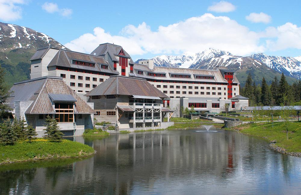 Alaska. Girdwood. Chugach Mountains. Alyeska Resort and Hotel sits against the Chugach National Forest, providing tourists acres of wilderness to explore.