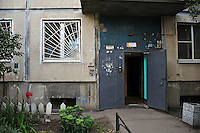 A doorway in the residential apartment blocks directly opposite the Salt Pier, where river boats moor in St. Petersburg, Russia.